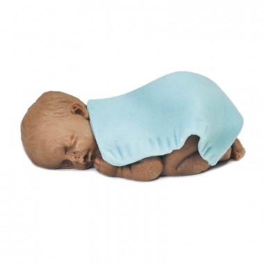 Dunkelhäutiges Marzipan-Baby mit Decke, blau