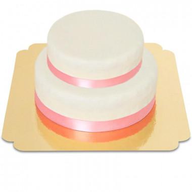 Zweistöckige weiße Torte mit Tortenband