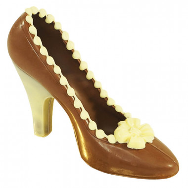Brauner Schokoladen-Schuh mit weißen Highlights